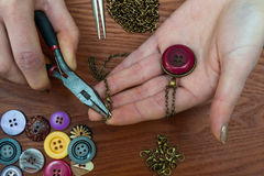 Close up of hands making jewellery Stock Image