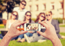 Close up of hands making picture of group of teens Stock Photos