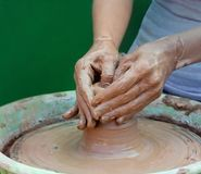 Close-up of hands making pottery on a wheel Royalty Free Stock Image
