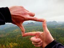Close up hands male fingers frame above landscape Royalty Free Stock Images