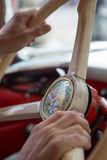 Close up of hands of a man holding the steering wheel of a vinta Stock Photo