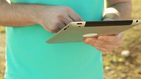 Close up of hands man using tablet outdoor stock video footage