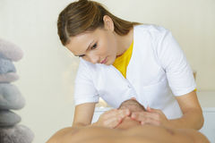 Close up hands masseuse massaging male neck Royalty Free Stock Photos