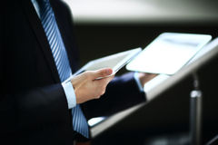 Close up hands multitasking man using tablet Stock Images