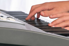 Close up of hands on a musical keyboard Royalty Free Stock Photo