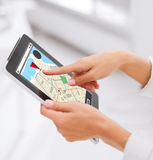 Close up of hands with navigator map on tablet pc Royalty Free Stock Photography