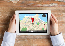 Close up of hands with navigator map on tablet pc Royalty Free Stock Photo
