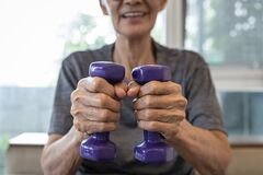 Free Close Up,hands Of Senior People Holding Dumbbells While Working Out,old Elderly Lifting Dumbbell Weights,daily Workouts At Home, Royalty Free Stock Images - 208794049