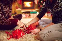 Close up of hands packing gift Royalty Free Stock Photo