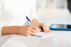 Close up of hands with pen writing to notepad Stock Images