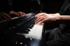 Close up of hands of piano player royalty free stock photos