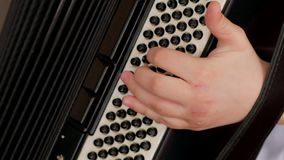 Close up on hands playing accordion stock video