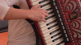 Close up on hands playing accordion stock footage