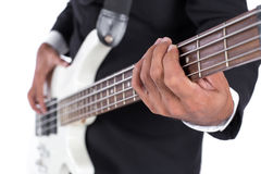 Close-up of hands playing a Bass Guitar on white background.  Royalty Free Stock Images
