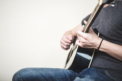 Close up of hands playing guitar Stock Image