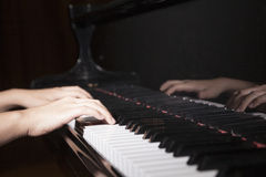 Close-up of hands playing the piano Stock Image
