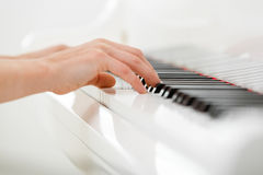 Close-up of hands playing piano Stock Image