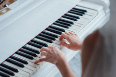 Close up of hands playing piano. Stock Images