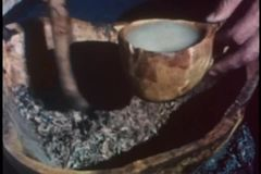 Close-up of hands pouring melted animal fat into bowl with dried meat stock video