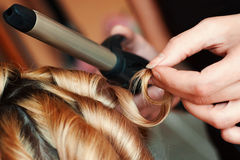 Hairdresser curl hair royalty free stock photography