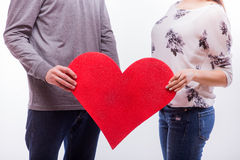 Close up of hands with red heart romantic love hipster couple. Royalty Free Stock Images
