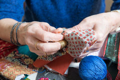 Close-up of the hands of a seamstress Royalty Free Stock Images