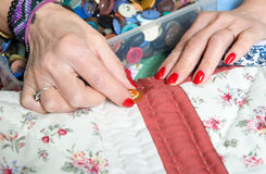 Close-up of the hands of a seamstress Stock Photo