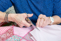 Close-up of the hands of a seamstress with scissors Royalty Free Stock Images