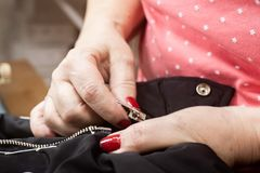 Hands of a seamstress working royalty free stock photography