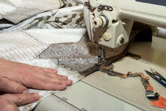 Close up hands of seamstress working on sewing machine Royalty Free Stock Photography