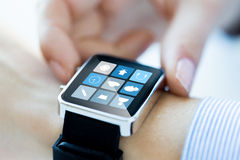 Close up of hands setting smart watch application Stock Photo