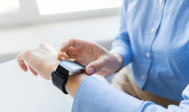 Close up of hands setting smart watch Royalty Free Stock Photography