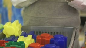 Close-up of hands of boy playing with building kit stock video footage