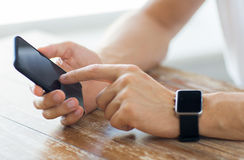 Close up of hands with smart phone and watch Stock Photo