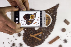 Close up of hands with smartphone taking picture. Of cup of coffee market Stock Photos