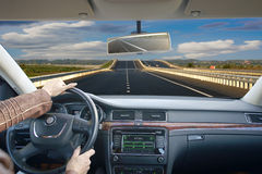 Close up of hands on a steering wheel. Driving by car schosse. Business trip Stock Image