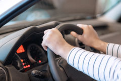Close up of the hands on steering wheel Royalty Free Stock Photos
