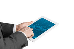 Close up of hands with tablet and forex screen. Royalty Free Stock Photos