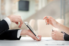 Close-up of hands with tablet and laptop. Businessmen on corpora Royalty Free Stock Photos