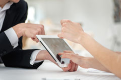 Close-up of hands with tablet and laptop. Businessmen on corpora Stock Photo