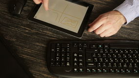 Close up Of Hands With Tablet At Wooden Desk stock footage