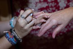 Detail of the hands of a two woman royalty free stock photography