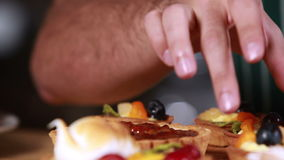 Close up hands tidying the pastries stock footage