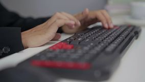 Close-up of hands typing on a computer keyboard. Close-up of hands typing on computer keyboard stock footage