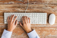 Close up of hands typing on keyboard Royalty Free Stock Photos