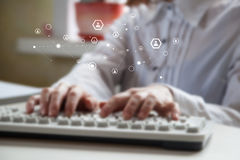 Close-up of hands typing on keyboard. Female office worker typing on the keyboard. Blurred image royalty free stock photography