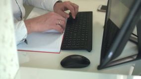 Close-up of hands typing on a keyboard in an home office. Fhd stock footage