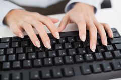 Close up of hands typing on a keyboard Royalty Free Stock Photos