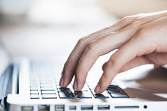 Close-up of hands typing on keyboard (Selective focus) Royalty Free Stock Images