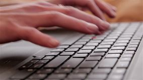 Close-up of hands typing on a laptop stock footage